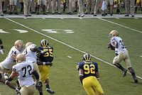 20090912_Theo_Riddick_runs_as_Brandon_Graham_gets_loose_in_the_backfield (1)